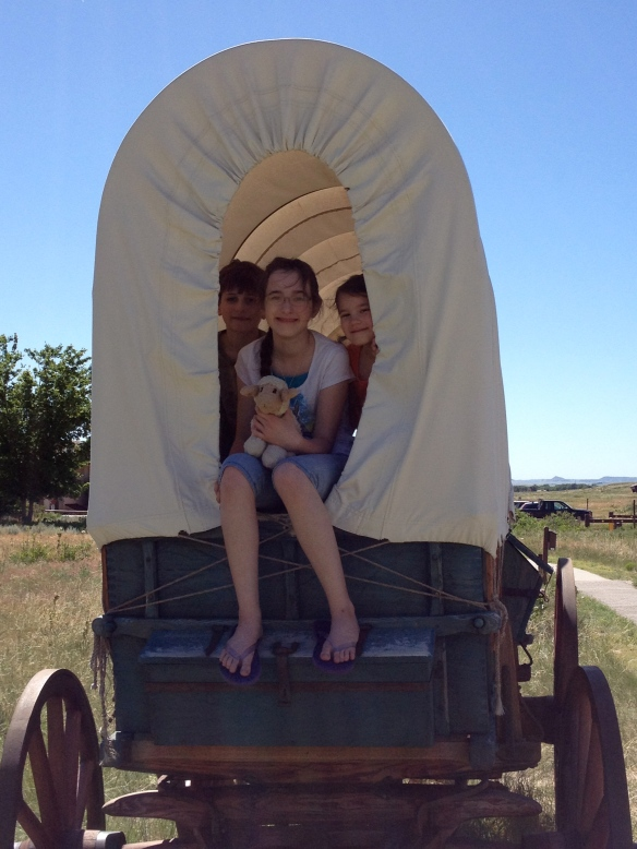 After I made them climb up for the picture, I saw a sign that said to stay off the wagons. Laura Ingalls would smack me if she knew I'd broken the rules!