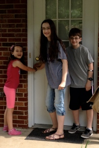 The kids stopped for one last picture as they closed the door on our old house.