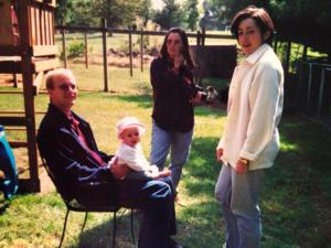 The Picture: Andrew on the left, me on the right, an aunt and a niece with us. That's not our baby, by the way. That was before offspring. Interestingly enough, I look surprisingly like my sister.